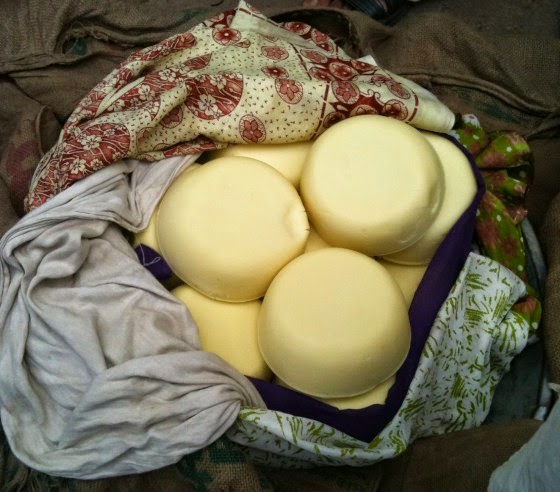 Khoya ''cakes'' wrapped in sarees and dupatta(s) in old Delhi's Khoya Market (Photo Courtesy : eatanddust)